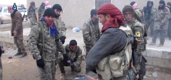 Militia fighters in Raqqa (Qasioun News Agency wikimedia)