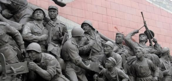 Patriotic statues of war in North Korea. / [Image by Stefan Krasowski via Flickr, CC BY 2.0]