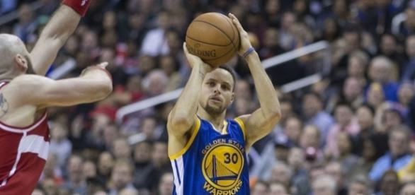 Golden State Warriors guard Stephen Curry shooting the ball. Image Credit: Keith Allison, Flickr -- CC BY-SA 2.0