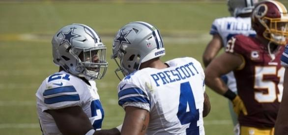 Dallas Cowboys' Dak Prescott and Ezekiel Elliott alongside each other. Image Credit: Keith Allison, Flickr -- CC BY-SA 2.0