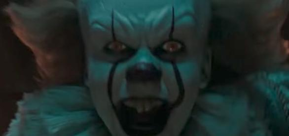 """The horror film """"IT"""" will top the box office for a second-straight weekend. [Image via Film Select Trailers/YouTube]"""