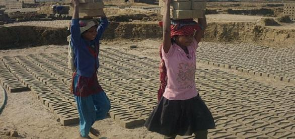 Children working as slaves credits:wikipedia https://en.wikipedia.org/wiki/Debt_bondage#/media/File:Child_Labour_in_Brick_Kilns_of_Nepal.jpg