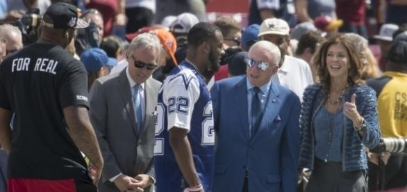 Jerry Jones speaking with player John Wall, by Keith Allison