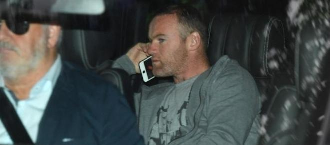 Rooney facing divorce after being caught with another woman