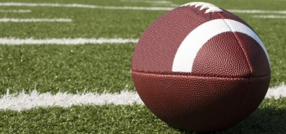 A football on a field [Image by U.S. Department of Agriculture  Flickr  Cropped   CC BY- 2.0 ]