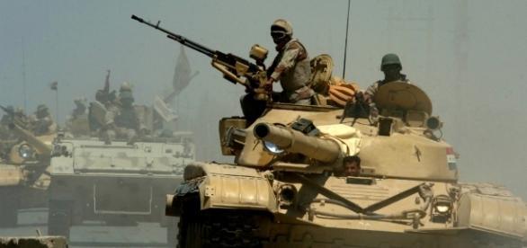 Iraqi T-72 tanks pass through a checkpoint in Mushahada, Iraq   Photo from Michael Larson via Wikipedia Commons.
