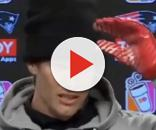 Tom Brady was wearing red gloves on both hands during Friday's press conference (Image Credit: The Wildcard/YouTube)