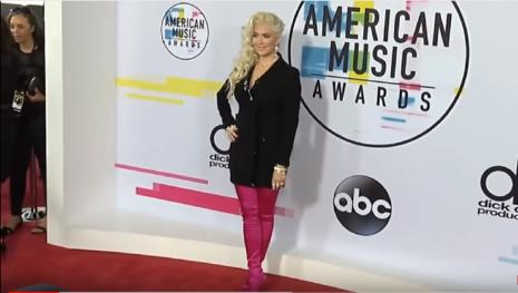 Erika Jayne slays at the American Music Awards in hot pink thigh-high boots