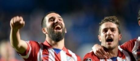Arda Turán, Godin y Koke con el Atlético.