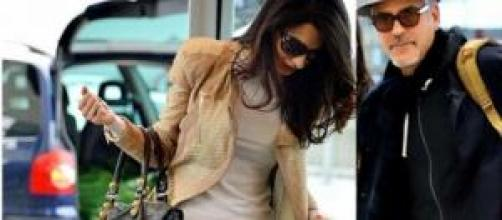 Clooney e Amal Alamuddin a Heathrow (Londra)