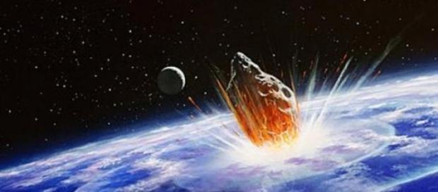 Un asteroide colisionando con nuestro planeta.