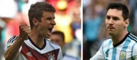 Thomas Muller and Lionel Messi prepare to face-off
