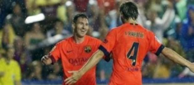 Messi y Rakitic celebrando un gol