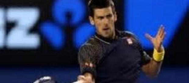 Williams and Djokovic through on day four
