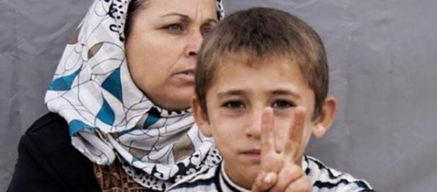 Madre e figlio curdi;vittoria a Kobane contro ISIS
