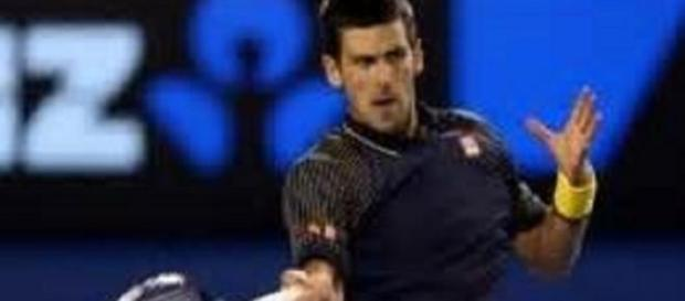 Djokovic comfortably through against Raonic