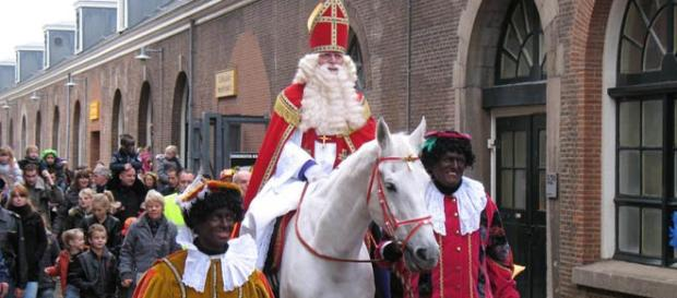 Saint Nicolas bringing gifts to the children