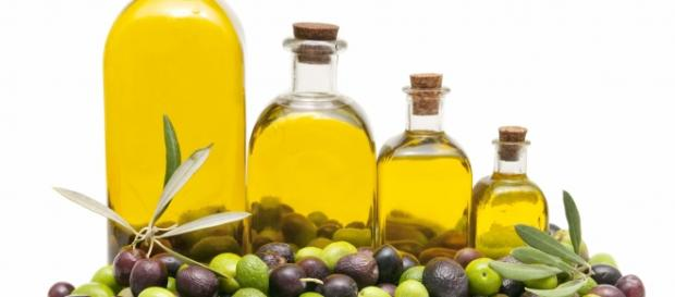 Bottles of olive oil, and colourful olives
