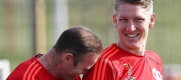 Schweinsteiger with Rooney who is also injured