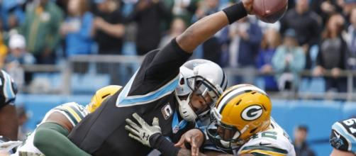 Newton soars for dunk at goal line; 3 TDs passing.
