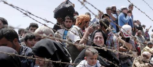 Refugiados Sirios que escapan de Siria