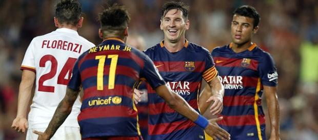 Messi y Neymar celebrando un de los goles al Roma.
