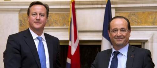 Cameron y Hollande en un saludo