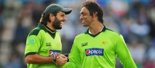 Afridi (left) almost gave Pakistan an unlikely win