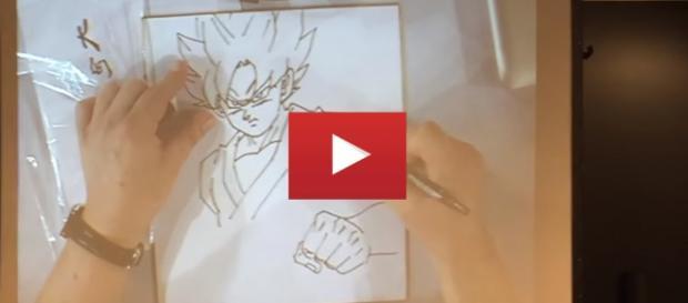 El artista japones diseñando a Goku