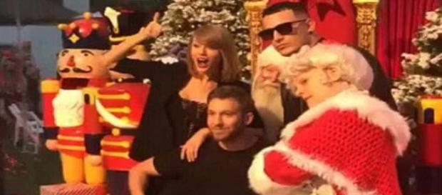 Taylor Swift and Calvin Harris at Christmas party.