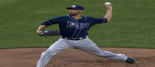Pitcher David Price signs with the Boston Red Sox.