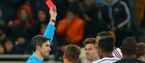 Xabi Alonso gets sent-off in the 65th minute