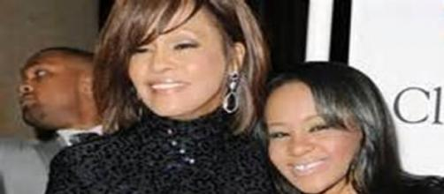 Whitney Houston junto a su hija Bobbi Kristina