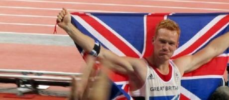 Rutherford winning the Olympic long jump title