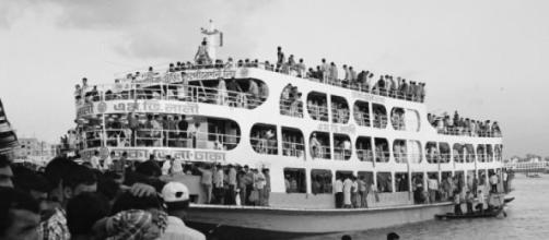 Overcrowded ferry on shores of the Padma River