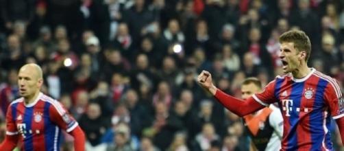 Thomas Muller celebrates scoring Bayern's opener