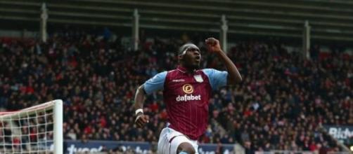 Benteke celebrates scoring Villa's fourth goal