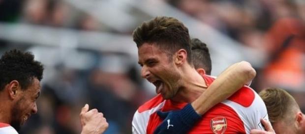 Olivier Giroud celebrates his brace for Arsenal