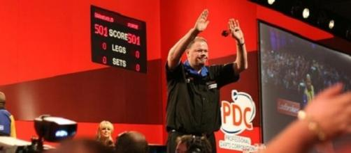Van Barneveld is in the elimination battle