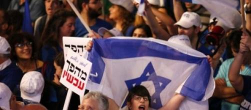 """O mote foi """"Israel quer uma mudança""""."""
