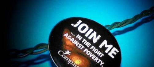 Badge asking the public to help fight poverty