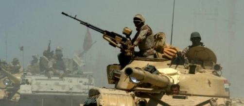 Iraqi Army tanks and APC advancing
