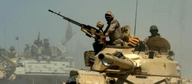 Iraqi Army tanks and APC advancing