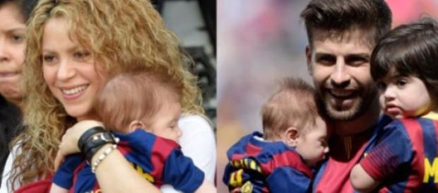 Shakira e Piqué sorridentes com os filhos