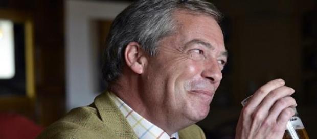 UKIP leader Nigel Farage enjoying a beer.