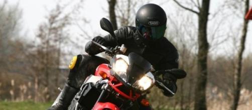 Rider atop an Aprilia sports motorcycle 1000cc