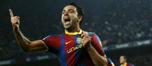 Xavi, celebrando un gol con el Barcelona