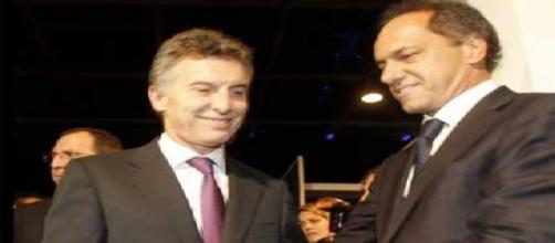 Macri y Scioli, competidores