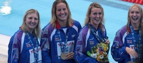 Becky Adlingon (left) during her swimming days