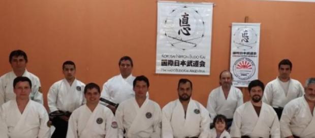 Javier Machado junto a un grupo de alumnos